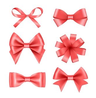 リボン付きの弓。お祝いやパーティーのベクトルの現実的な写真のサテンシルク装飾