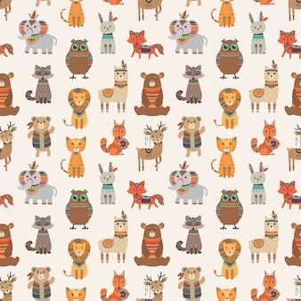 部族の動物のシームレスなパターン。エスニックスタイルの動物のテクスチャ