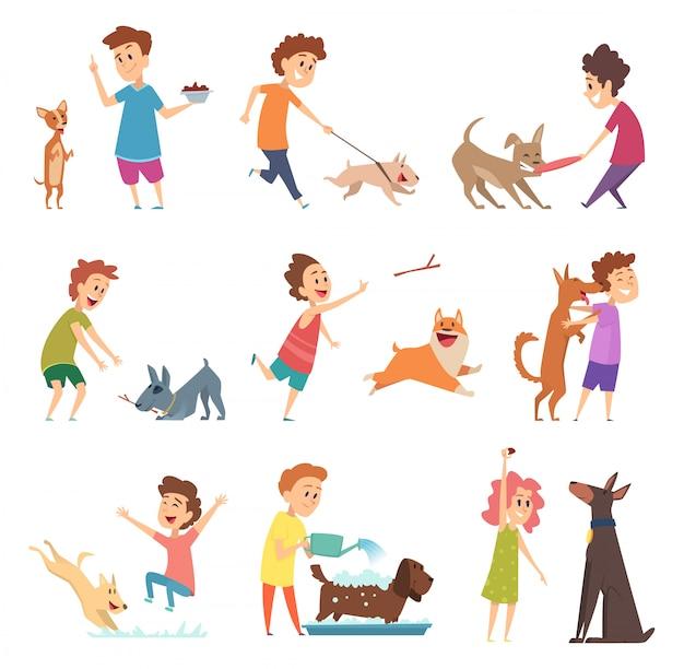 ペットと子供。幸せな子犬の犬と飼い主が笑顔の餌やり動物を遊んでハグ