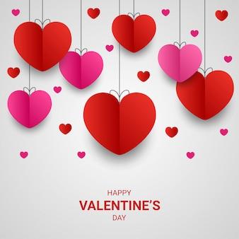 幸せなバレンタインデーの紙は、白でカラフルなハート形のスタイルをカット