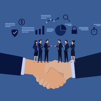 実業家チームの手が交渉を振る。