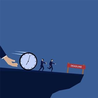 ビジネスマンの締め切りのための時計で追いかけて実行