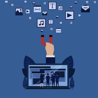 ビジネスチームはノートパソコンの手からウェブを見てウェブサイトのフルメディアコンテンツのマグネットプルコンテンツメディアのメタファーを保持します。