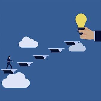 ビジネスマンが空飛ぶ本を登って、アイデアを見つけるというアイデアのメタファーに到達します。