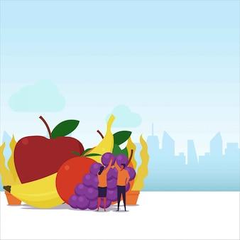 健康食品フラットカップルは、果物のスタックからブドウを取ります。