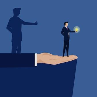 ビジネスマンはアイデアのようなアイデアの影を保持します。