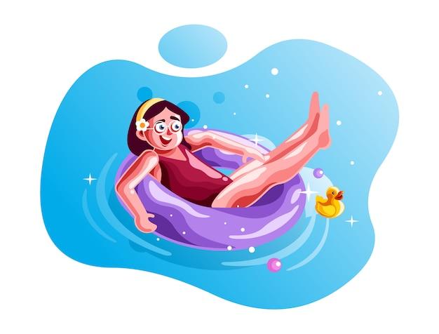 リングブイと一緒に泳ぐ少女