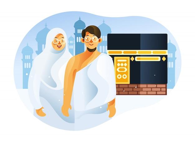 Пара мусульманин перед меккой каабы, одетая в ихрам в исламском паломничестве хадж