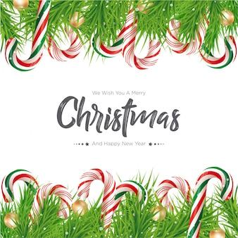 枝の背景を持つクリスマスキャンデー杖