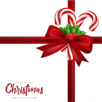 Рождественская подарочная карта с красным бантом, еловыми ветками и леденцами