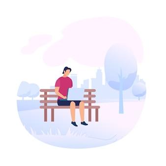 ラップトップとベンチに座っている若い男の文字