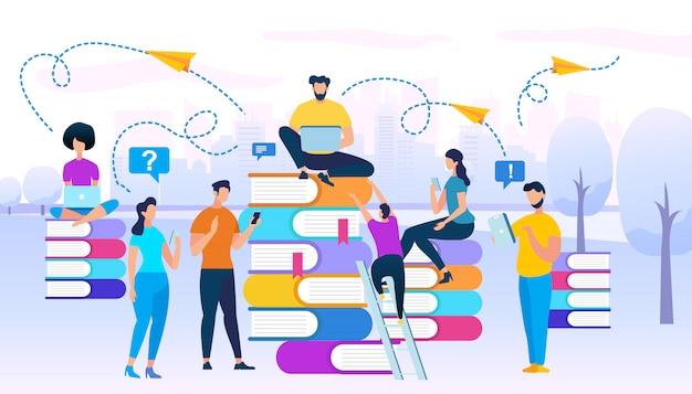 一緒に研究している若者たちが本の山に座る