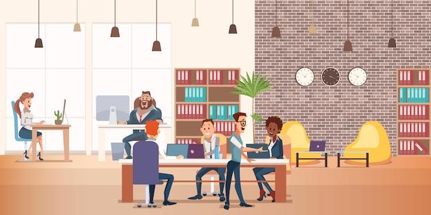 創造的な人々とのコワーキングスペースがテーブルに座る