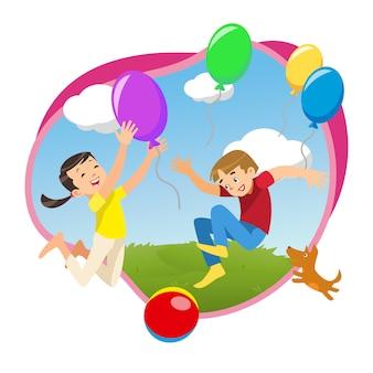 風船で公園で遊んでいる子供たち