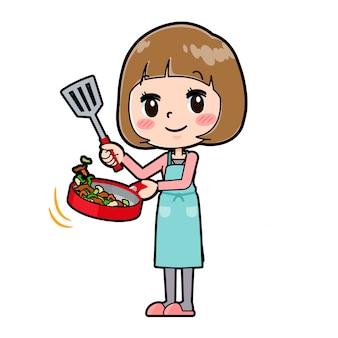 ピンクの服を着た女性が炒め物を炒める