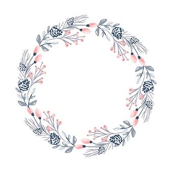 クリスマスの花の花輪と常緑の枝に赤い果実