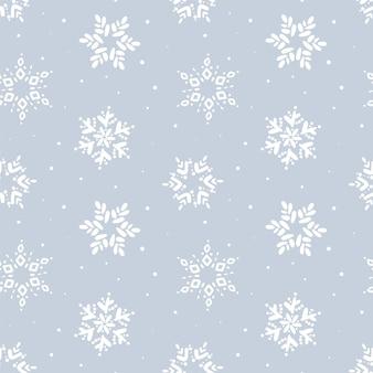 クリスマスのシームレスなパターン。冬のスノーフレークパターン