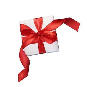 白で隔離される透明に赤の弓とギフトボックス