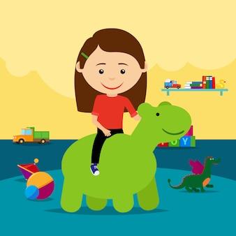 Девочка верхом на резиновой игрушке в детском саду
