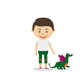 小さな男の子は彼のおもちゃのドラゴンを示しています
