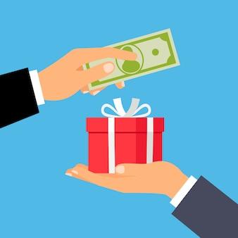 Руки с деньгами и подарочной коробкой