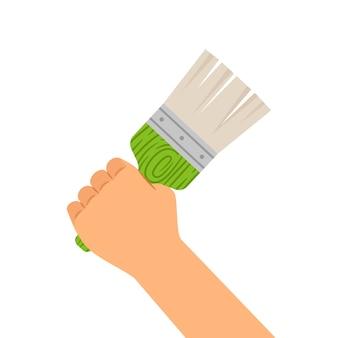 白で隔離されるブラシを持つ手