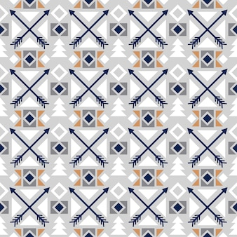矢印の装飾と色の民族のシームレスパターン
