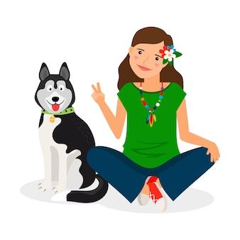 シェパードの犬とヒッピーの女の子