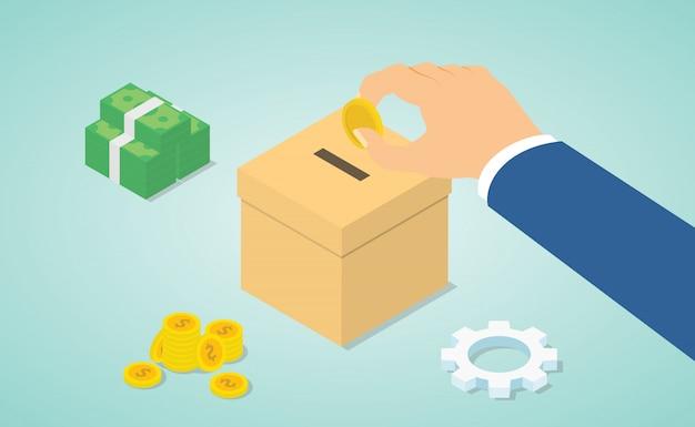 手で寄付の概念は、等尺性のモダンなフラットスタイルでお金と寄付ボックスで寄付するお金を与える
