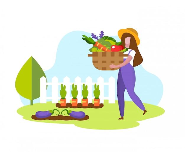 Женщина в комбинезоне с корзиной свежих овощей