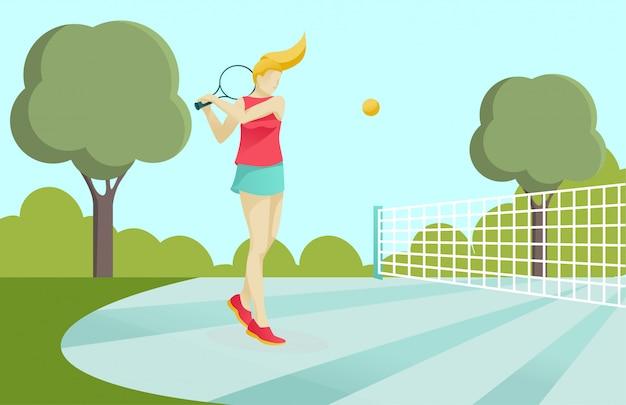 公園のコートでテニスをしてアクティブなスポーティな女の子