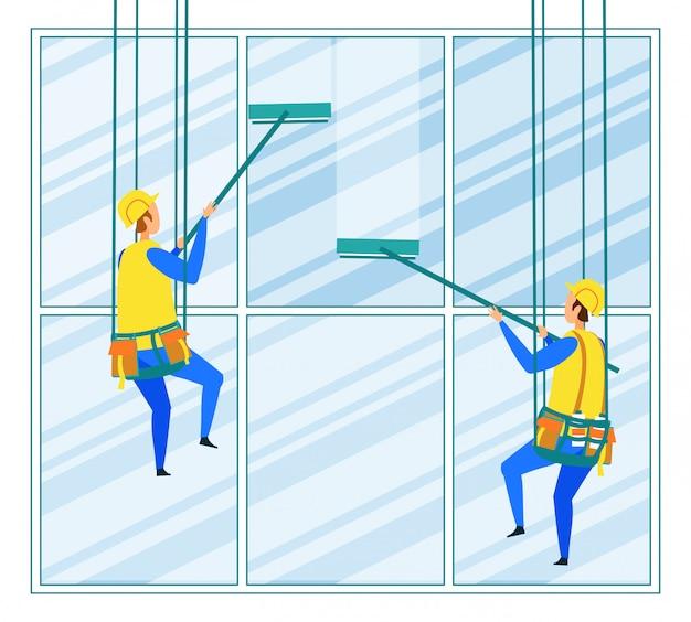 産業登山家労働者が建物の外観を洗う