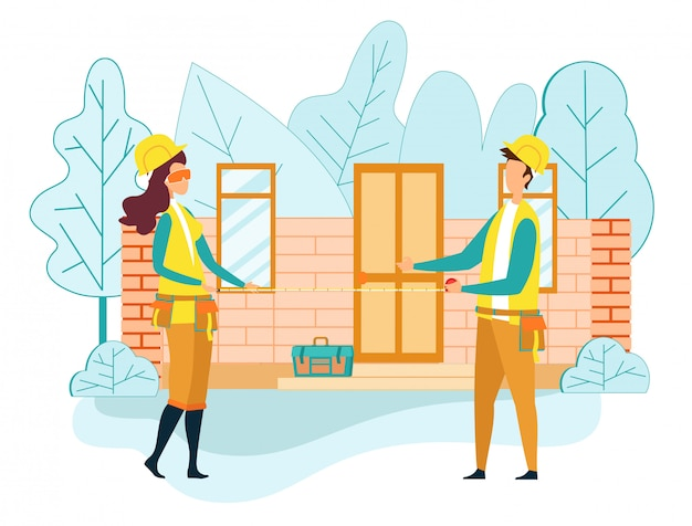 Рабочий инженер строит дом держит мерную ленту