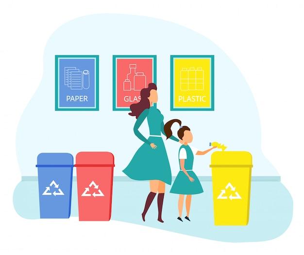 母と娘がゴミを容器に捨てる
