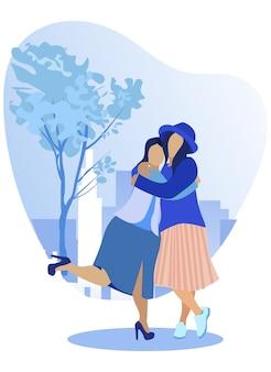 喜んで互いに抱き締める女性の友人