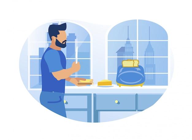 若い男が自宅の台所でバタートースト