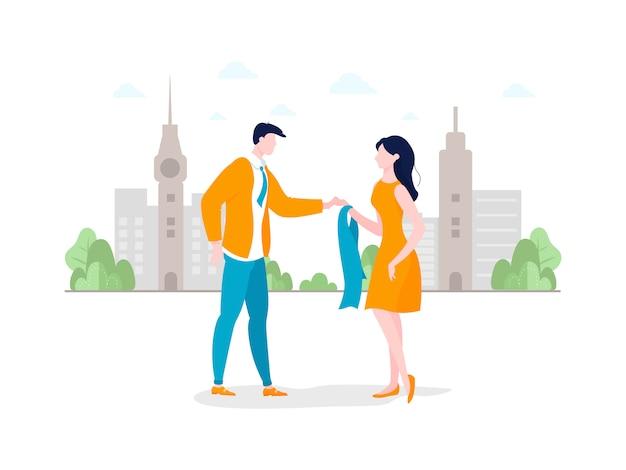 Красивая пара гуляет по городу или парку