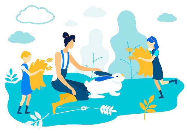 Женщина гладит белого зайца на поле. девочки с сеном
