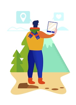 若い男は山の自然の風景の写真を作る