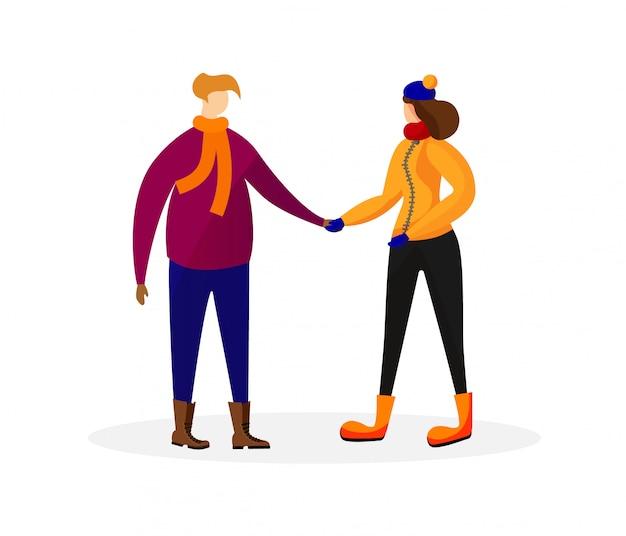 Мужчина и женщина в зимней одежде, держась за руки