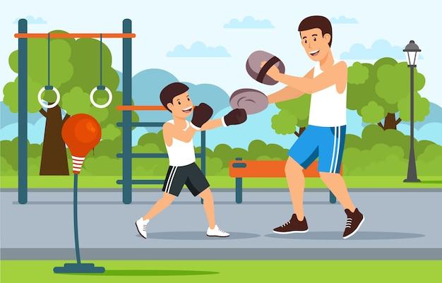 遊び場の父は息子のボクシングを教えています。