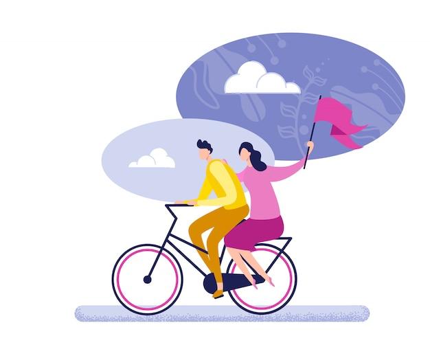 リサイクルフラグフラットで自転車に乗るカップル。