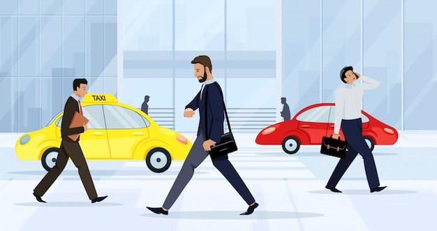 ビジネスの男性と女性が通りを歩いています。