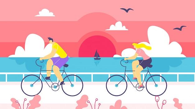 男と女の海岸漫画に沿って自転車に乗る。
