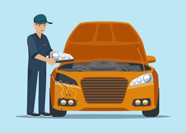 男労働者は黄色の車のヘッドライトを変更します