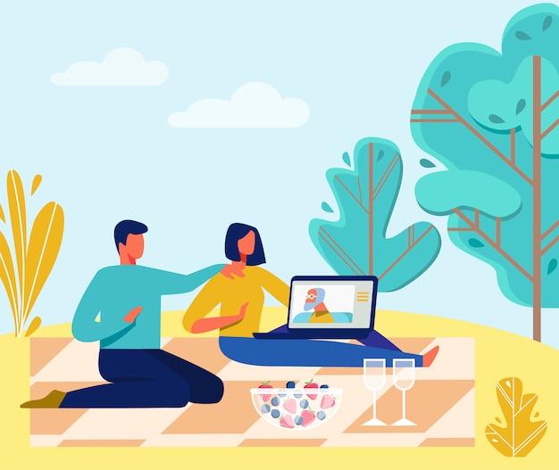 古い親とビデオ通話を持つピクニックに家族