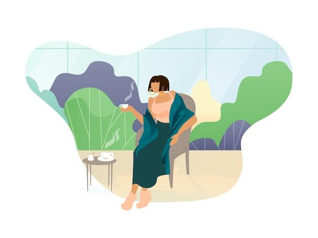 女性は温室で一杯のコーヒーと残りを楽しんでいます
