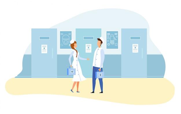 Врачи, стоящие в научном лабораторном коридоре