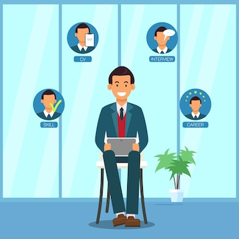 ビジネススーツを着た男が椅子にタブレットで座っています。