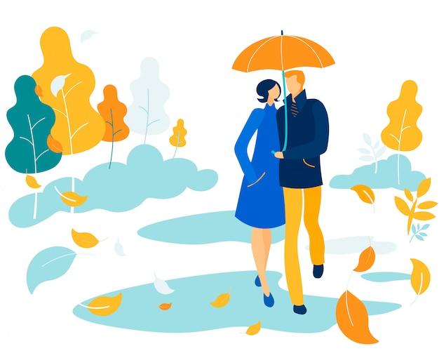公園で傘の下で愛する幸せなカップル寄り添う